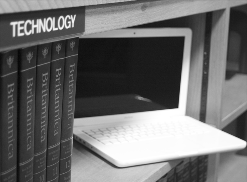 Image of computer on shelf